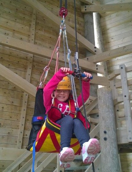A PALS member climbing using specialised equipment