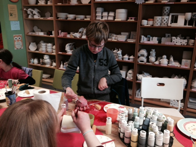 PALS member taking part in a painting pottery activity